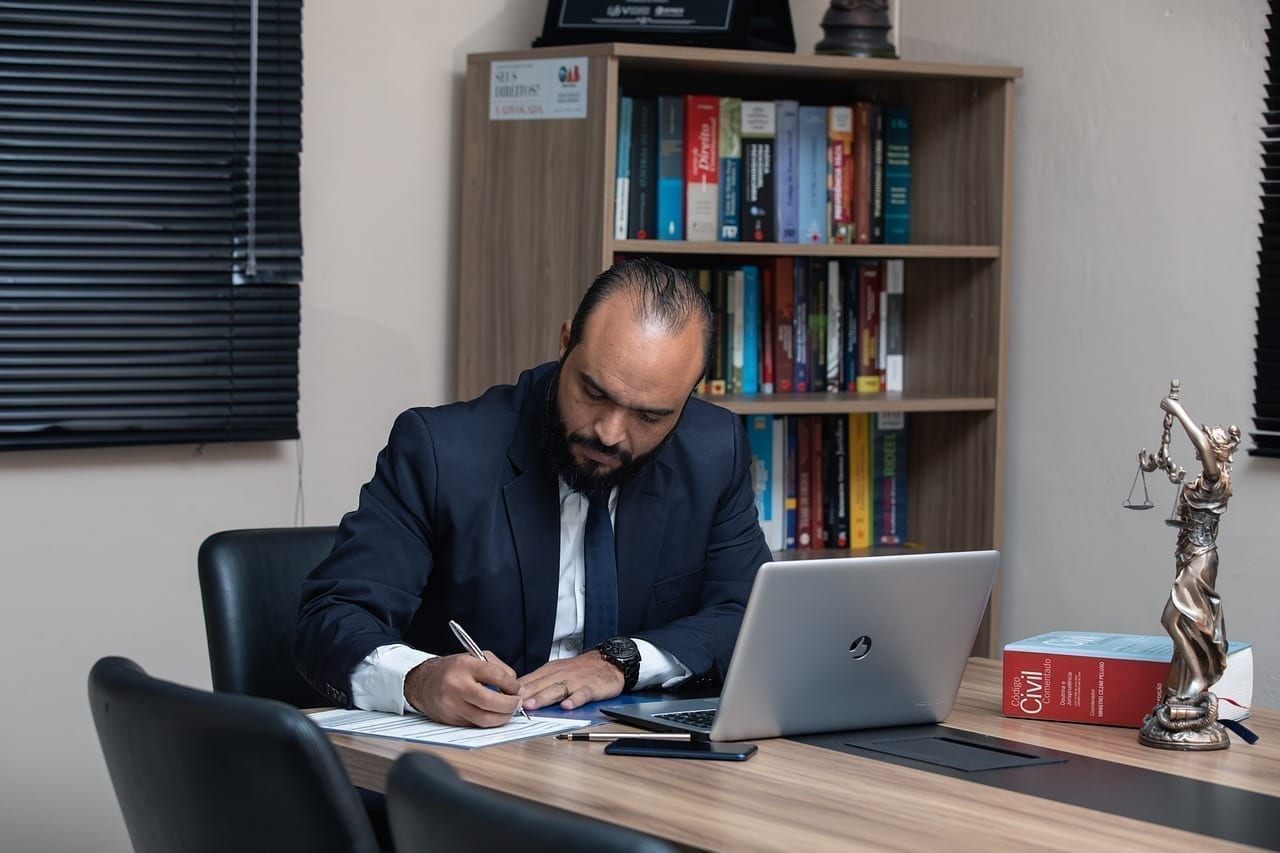 Bankruptcy lawyer writing in his office