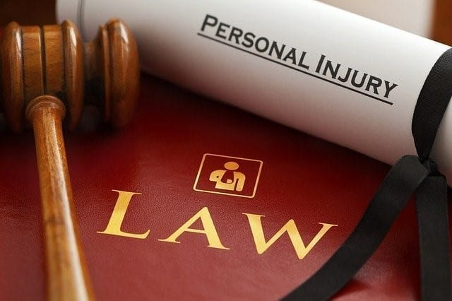 Mallet on top of a personal injury law book