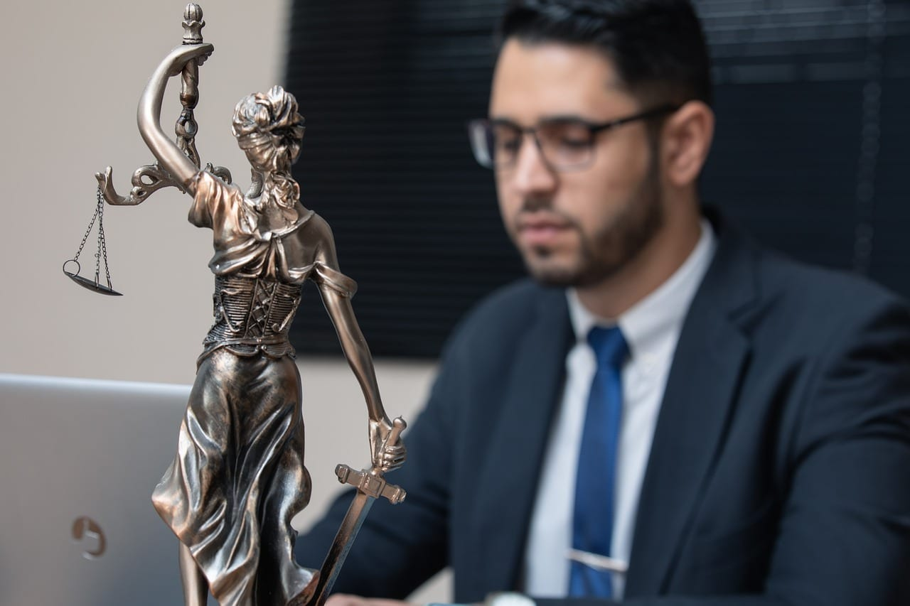 Lawyer typing on a laptop
