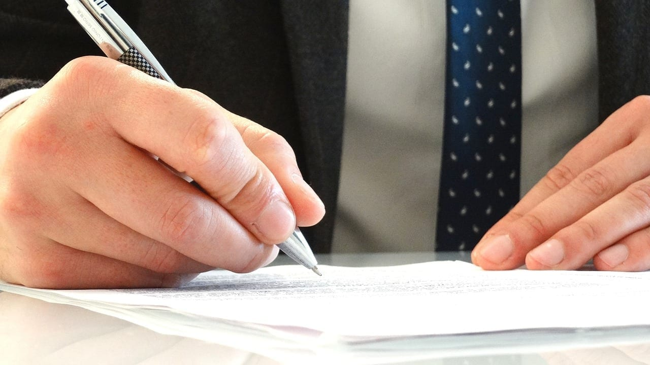 Lawyer writing on a sheet of paper
