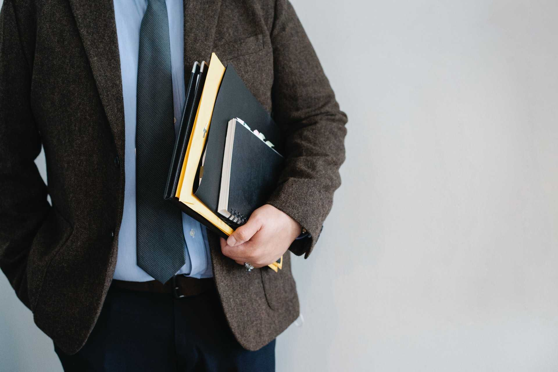 Lawyer carrying documents containing bankruptcy information