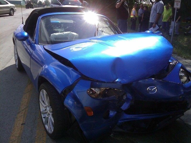 Crashed blue car after a car accident