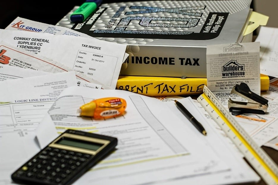 Documents and tax books on a desk