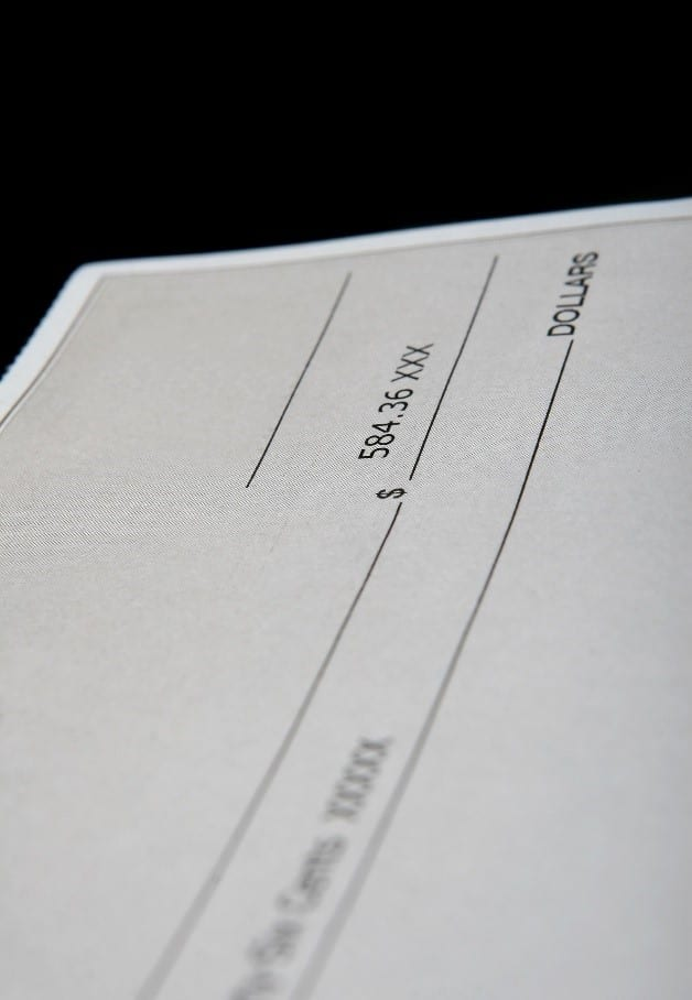 A check containing an amount in dollars