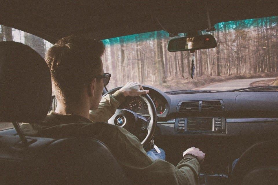 Teen driving a car