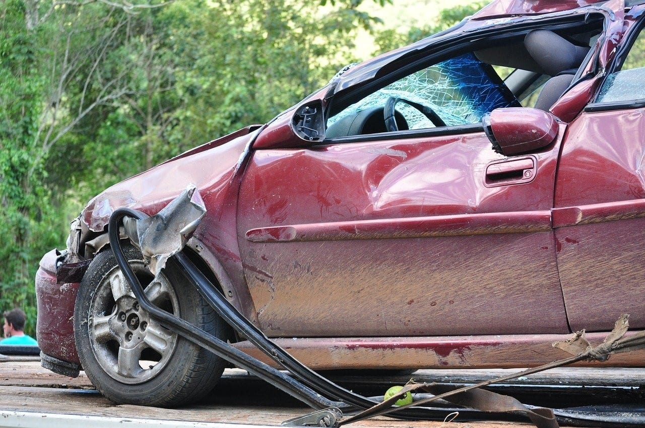 Red car damaged from collision