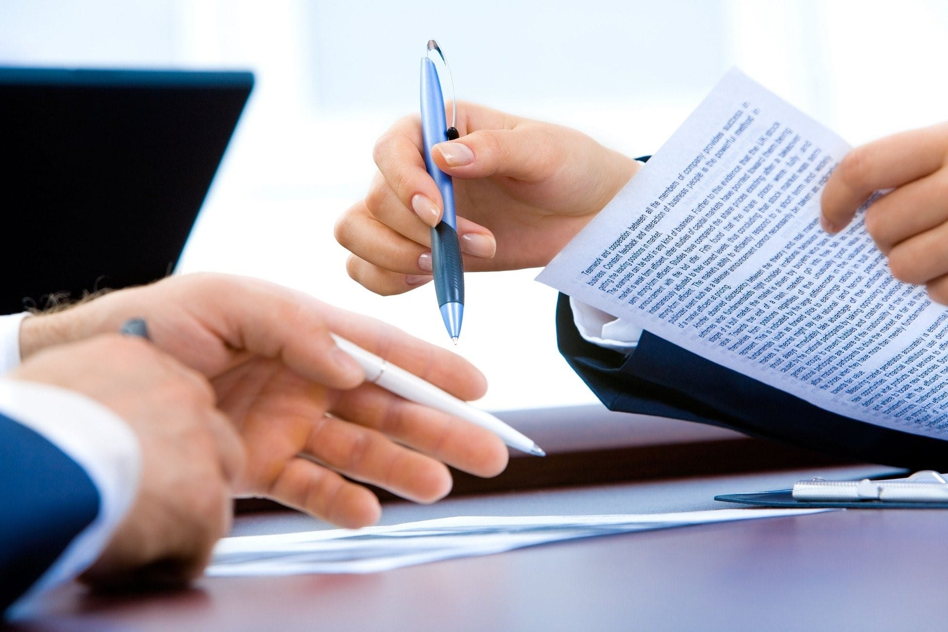 Lawyer and client having a discussion over legal documents