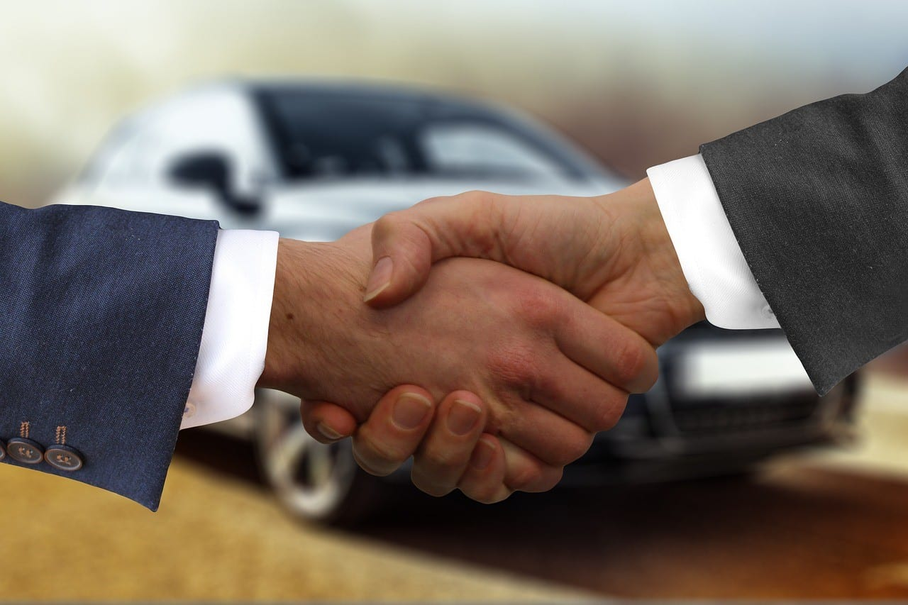 Client and attorney shaking hands