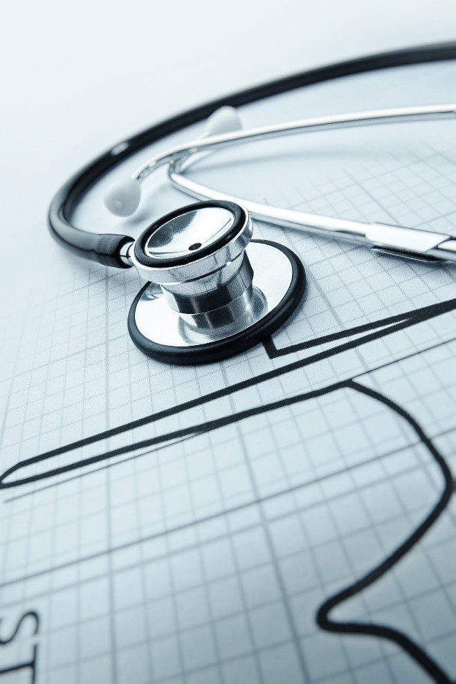 A stethoscope placed on a graph paper