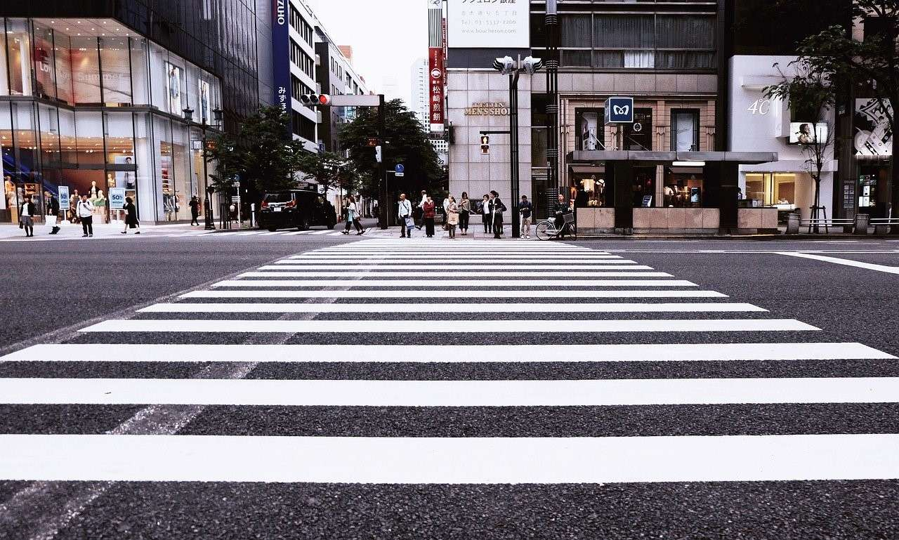 Pedestrians waiting to cross the road